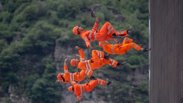 Performance of members of the theatre Dimitri on the opening day of the Gotthard rail tunnel.