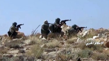 Hezbollah fighters taking position during clashes with al-Qaeda-linked militants in an area on the Lebanon-Syria border in July.