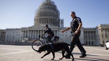 US Capitol Police officers keep watch over the East Front of the Capitol after a fresh threat from Islamic State.