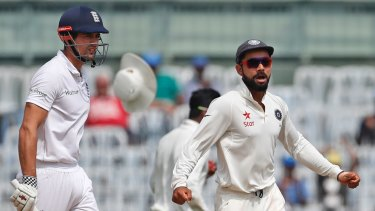 Future clouded: India's captain Virat Kohli, right, celebrates the dismissal of England's captain Alastair Cook during the fifth Test.