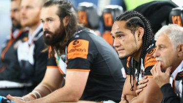 Dejected: Aaron Woods and Martin Taupau look on during the Tigers' loss to the Roosters on Friday.