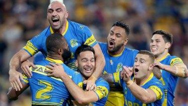 Statement win: Parramatta players celebrate a try.