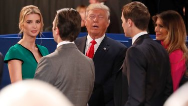 Republican presidential nominee Donald Trump, centre, talks to his daughter Ivanka Trump, left, Donald Trump, Jr., Ivanka's husband Jared Kushner and his wife Melania Trump after the second presidential debate  in St Louis.