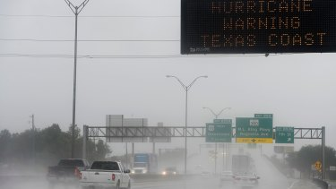 A sign above Interstate 10 in Beaumont, Texas, warns travelers to stay away from the coast as Hurricane Harvey bears down on the state.