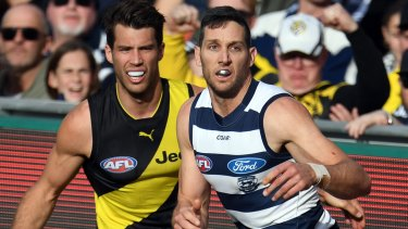 Alex Rance of the Tigers (left) and Harry Taylor of the Cats will face off again in two weeks time.
