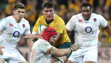 Contained: Sean McMahon is tackled by James Haskell.