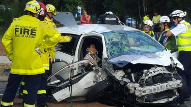 A five car pile-up in Sackville Street, Canley Vale, left six people injured and one trapped.