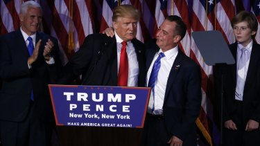 U.S. President-elect Donald Trump, left, embraces Reince Priebus, chairman of the Republican National Committee.