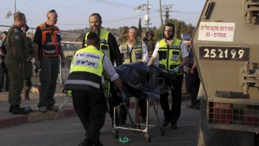 Israeli emergency services evacuate the body of a Palestinian from the scene of an attack near the West Bank Gush Etzion settlements on Sunday.