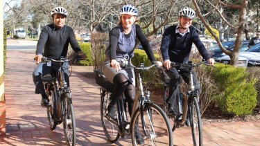 The trial of pedal-assisted electric bicycles, or e-bikes, is being rolled out across ACT government workplaces. Udaya Kumar, left, Nicola Plunkett-Cole and Richard Horton try them out.