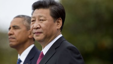 Chinese President Xi Jinping, right, and US President Barack Obama on the South Lawn of the White House in Washington.