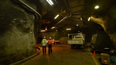 Bondi Waste Water Treatment Production Team Leader (right) walks through one of the underground tunnels at Sydney Water Bondi Waste Water Treatment Plant. 26th October,2015. Photo: Kate Geraghty