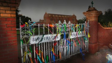Ribbons tied to the front gate of St Patrick's College in support of abuse victims.