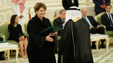 Lockheed Martin chief executive Marillyn Hewson shakes hands with a Saudi dignitary. The defence firm signed a $US6 billion letter of intent to build 150 Black Hawk helicopters in the kingdom.
