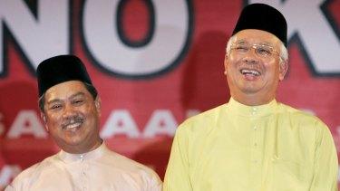 Malaysian Prime Minister Najib Razak (right) axed his deputy Muhyiddin Yassin share a lighter moment in 2009.