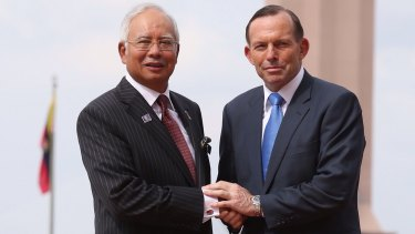 Malaysian Prime Minister Najib Razak, pictured here with  Australian Prime Minister Tony Abbott,  is under pressure in his home country to resign because of a series of corruption scandals.
