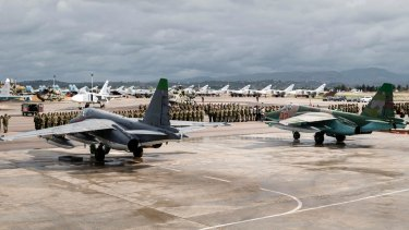 A line-up of Russian troops at the Hemeimeem air base in Syria. in March.