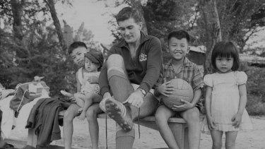 Gary Wilkins laces his boots before a training session in Saigon in 1967.