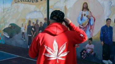 Armando Rodriguez, who smokes marijuana, wears a jacket with a marijuana leaf in San Francisco.