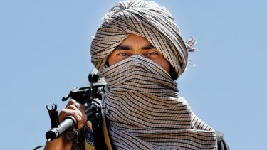 An armed member of a breakaway faction of the Taliban.