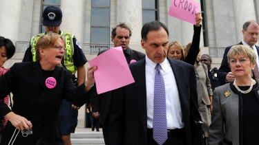 Lehman Brothers Holdings chief executive Richard Fuld is heckled by protesters. The failure of Lehman Brothers sent the world economy into a spin.