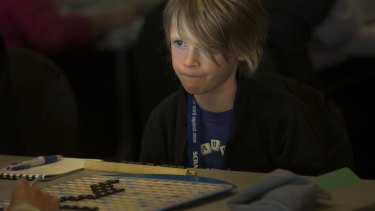 Eight-year-old Ronnie Bennett keeps a firm eye on the competition. Ronnie has twice been under-eight world champion.