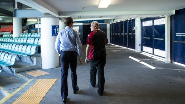 Phil Heads (left), communications director at the SCG Trust, shows the narrowness of the concourse at Allianz, which has been identified as a safety concern.