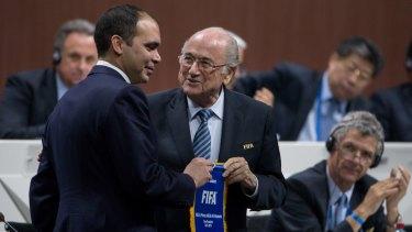 Jordanian Prince Ali bin-al Hussein and FIFA president Sepp Blatter shake hands before the vote.
