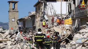 Rescuers work amid collapsed building in Amatrice.