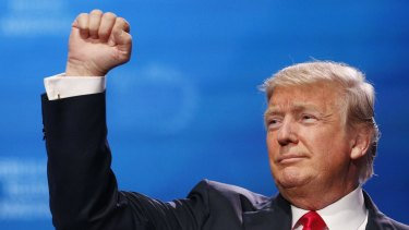 US President Donald Trump gestures after speaking