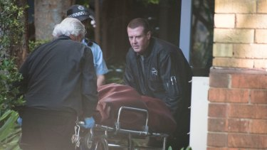 Ms Abek's body is taken away from a unit on  St Neot Avenue, Potts Point, on Thursday.