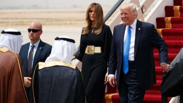 US President Donald Trump and first lady Melania Trump arrive at King Khalid International Airport.