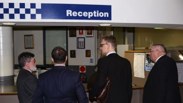 Legal representatives for Harriet Wran arrive at Cabramatta police station on Wednesday.