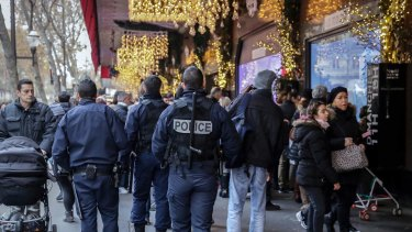French police officers patrol outside the Galeries Lafayette department store in Paris.