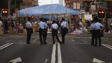 Softly, softly: despite the continuing protests, police in Hong Kong have maintained a low profile.