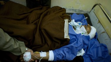 Sheikh Sulieman Ghanem, 75, receives medical treatment at Suez Canal University hospital after the attack on a mosque.