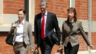 Enigmatic clan: Michael Wright's daughters Alexandra Burt (at left) and Leonie Baldock with solicitor Ben Luscombe.
