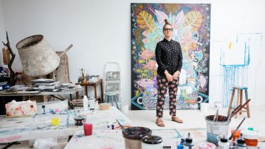 Del Kathryn Barton in her Paddington studio with the painting for the Spectrum Now Festival program.