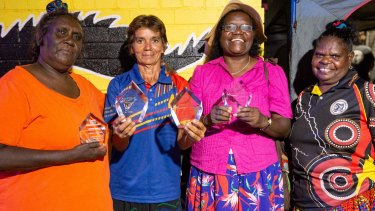 Barunga Festival organising committee members receive awards for a decade of service. From left, Suzina MacDonald, Annemarie Lee and Anita Painter with Lisa Mumbin (far right) of the Jawoyn Association.