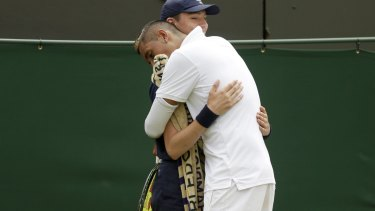 Nick Kyrgios of Australia hugs a ball boy during his match.