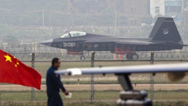 More weapons: A J-31 stealth fighter of the Chinese People's Liberation Army Air Force lands on a runway after a flying performance at the 10th China International Aviation and Aerospace Exhibition in Zhuhai, Guangdong.