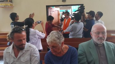 David Taylor's parents and brother in the front row of Denpasar District Court as David Taylor enters the courtroom.