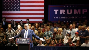 All about the flag: Donald Trump speaks during a rally in Iowa.