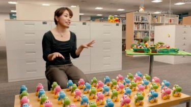 Software planner Emi Watanabe talks about her work on Yoshi's Wooly World. The plush, knitted amiibo toys were inspired by her attempt to mock up a real woollen Yoshi because he lacks the appropriate skills to create one in-game.