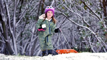 A wintry blast has delivered Autumn snow to the Alps. At Falls Creek four-year-old Lea Hocking wasted no time enjoying the snow.
