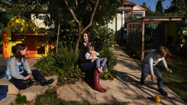 Liz Slakey with her children Luca Slakey 8 (left), Pippi Slakey 2 (2nd from right) and Declan Slakey 5 (right) in the backyard of their Haberfield home they are set to lose.