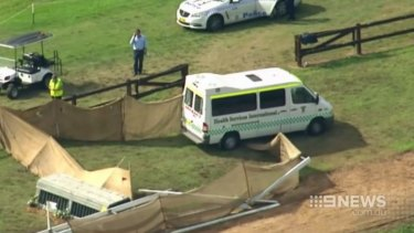 An ambulance at the scene of the accident where Caitlyn Fischer died competing in a cross-country event at the Sydney International Equestrian Centre.