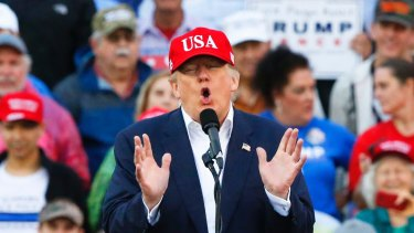 """""""There's no alt-right or alt-left"""": US President-elect Donald Trump at a rally in Alabama on December 17."""
