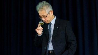 Suntory's chief blender Shinji Fukuyo samples whisky during a presentation of Suntory Holdings' whiskies in Tokyo.