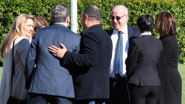 Eddie Obeid with members of his family and legal team during the trial.